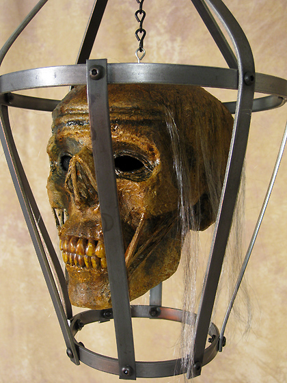 Iron Skull Cage with Corpsed Head
